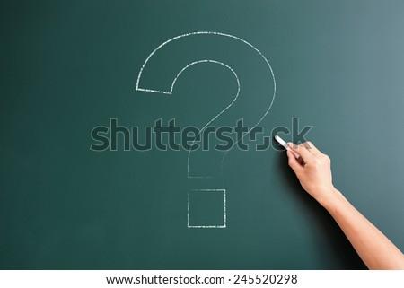 question mark drawed on blackboard - stock photo