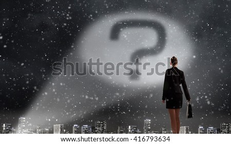 Question mark in darkness - stock photo