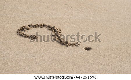 question mark in the sand