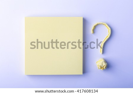 Question mark made of yellow sticky note is on white background. - stock photo