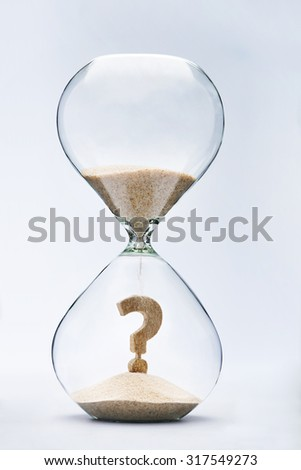 Question Mark made out of falling sand inside hourglass