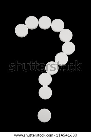 Question mark of white tablets isolated on black background - stock photo