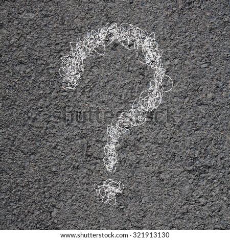 Question mark on an asphalt road - stock photo