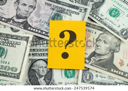 Question mark on dollar banknotes. - stock photo
