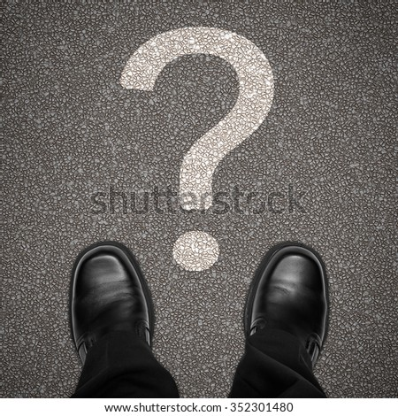 Question mark on road with business man shoes standing still, top view, looking down - stock photo