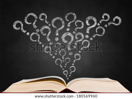 Question mark sign on blackboard popup from book - stock photo
