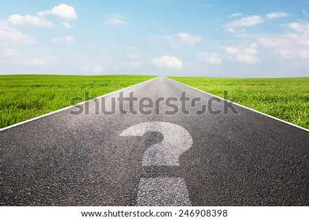 Question mark symbol on long empty straight road, highway. Conceptual - where do you go? - stock photo