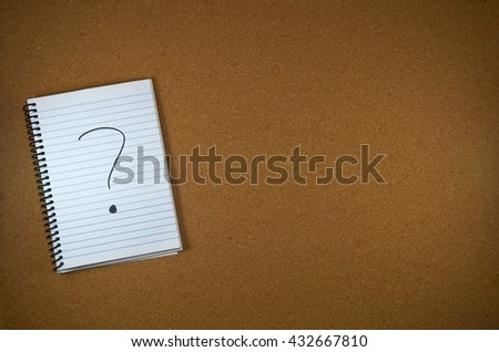 question mark written on a notebook - stock photo
