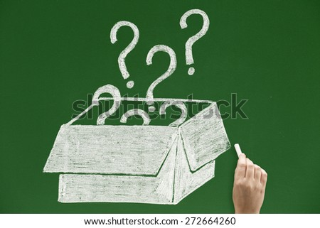 Question marks flying out of box Concepts and ideas on blackboards - stock photo