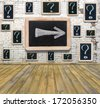 Question marks - white chalk drawing on small blackboard hanging old brick wall - stock photo