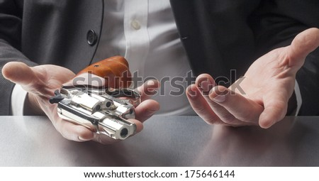 question of suicide with gun in hands at work - stock photo