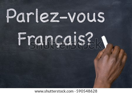 "Question ""Parlez-vous Francais?"" written on blackboard"