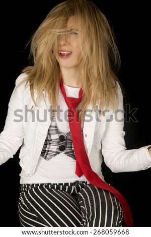 Questioning woman with messy hair sitting down - stock photo