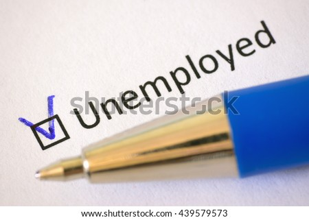 Questionnaire - blue pen and the inscription UNEMPLOYED with check mark on the white paper