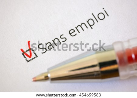 Questionnaire. Red pen and the inscription UNEMPLOYED with check mark on the white paper
