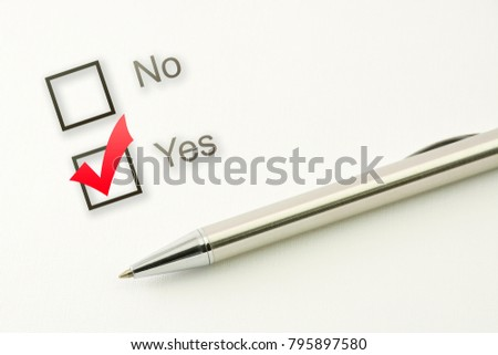 questionnaire: yes no choice, marked check box with a pen on paper background. Approval concept