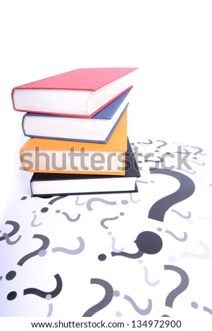 questions and books with the answers - stock photo