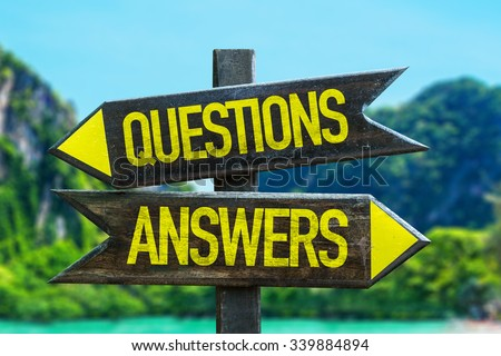 Questions Answers signpost in a beach background - stock photo