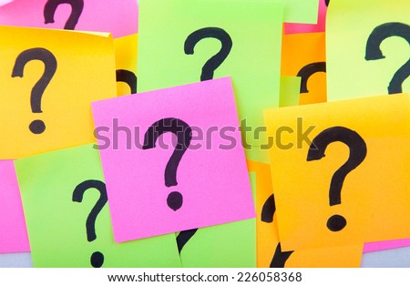 questions, decision making or uncertainty concept - a pile of colorful crumpled sticky notes with question marks - stock photo
