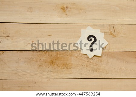 Questions mark heap on table concept for confusion - stock photo