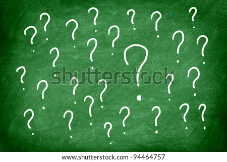 Questions. Question mark on green chalkboard / blackboard. - stock photo
