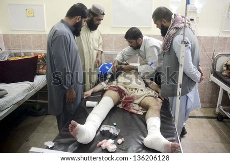 QUETTA, PAKISTAN - APR 23: Victim of Gawalmandi area bomb blast is being treated at  Civil Hospital on April 23, 2013 in Quetta. Several people were injured in three back-to-back blasts in Quetta.