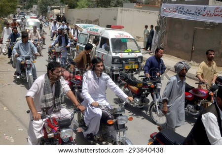 QUETTA, PAKISTAN - JUL 06: Members of Hazara Community along with dead bodies of  their community members as they are protest against their killing and Hazara genocide on July 06, 2015 in Quetta.