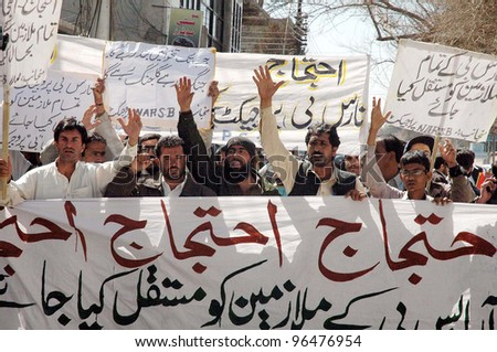 QUETTA, PAKISTAN - MAR 01 NARS-B Project employees chant slogans in favor of their demands during a protest demonstration at Quetta press club on Thursday, March 01, 2012. - stock photo