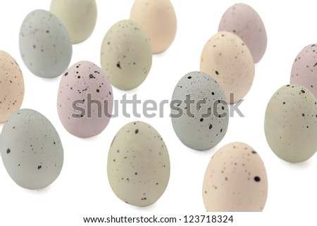 Queues of painted eggs with black specks isolated in a white background - stock photo