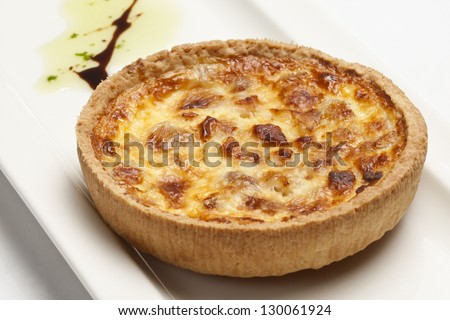 Quiche Lorraine (with bacon and eggs) on a white plate