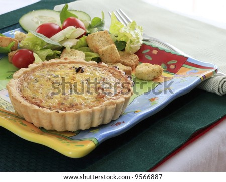 Quiche served with a salad - stock photo