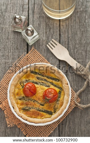 Quiche with asparagus and tomatoes with cup of wine - stock photo