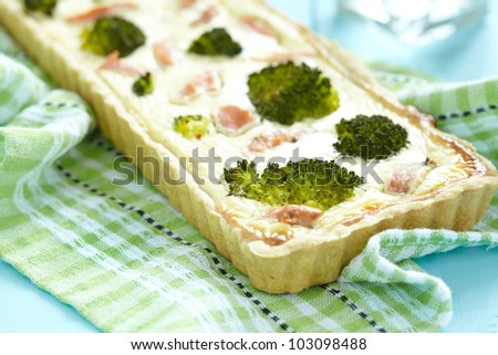 Quiche with broccoli and smoked salmon - stock photo