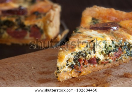 quiche with sausage and spinach - stock photo