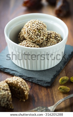 Quick energy snacks with dates pistachios and sesame seeds - stock photo