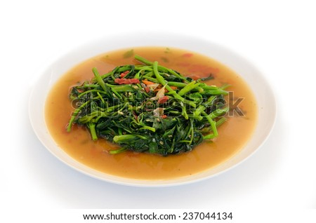 quick fried water spinach with chili and soy sauce - stock photo