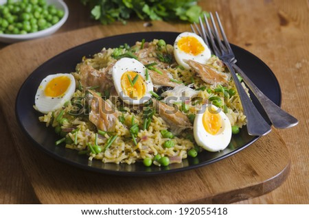 Quick kedgeree with smoked mackerel and herbs - stock photo