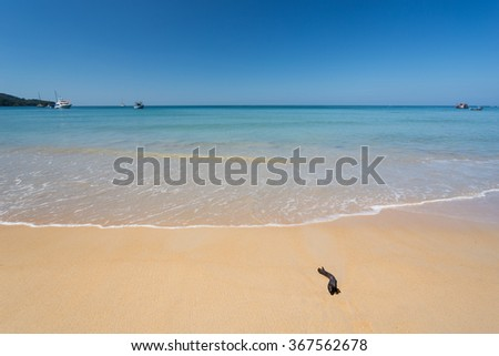 Quiet Andaman sea and blue sky on Nai Yang beach in Phuket Thailand