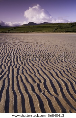 quiet beach ireland Dingle peninsula,sand hills and clouds - stock photo