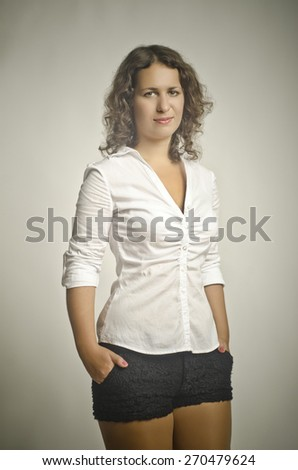 quiet, beautiful girl looks on a beige background