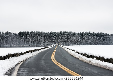 Quiet country road in the middle of winter. - stock photo