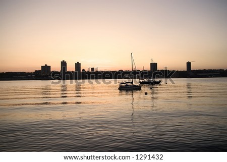 Quiet evening on Hudson river, New Jersey skyline.