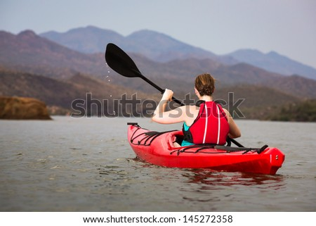 Quiet Paddle into the Mountains - stock photo