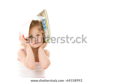 quiet pretty little girl with book on her head sitting on white background