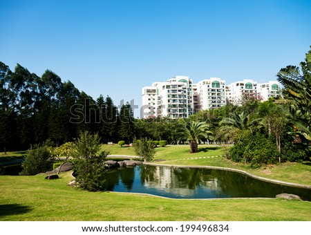 Quiet spring park with lake. - stock photo