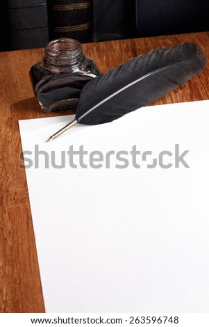 Quill, inkwell and a blank piece of paper to place your own text. - stock photo