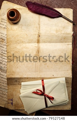 Quill, inkwell and old paper. - stock photo