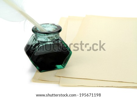 Quill pen and glass ink bottle with paper - stock photo