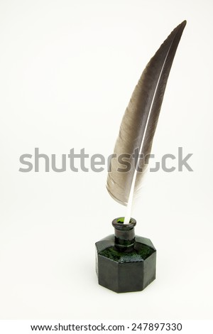 Quill  pen  and vintage glass inkwell isolated - stock photo