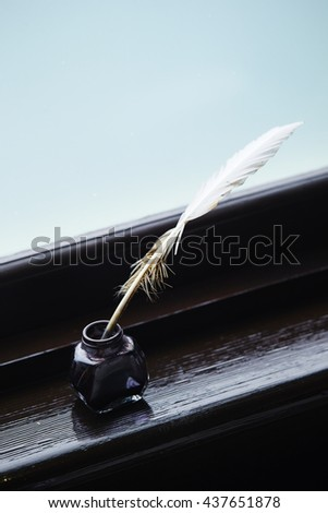 Quill pen with ink bottle - stock photo